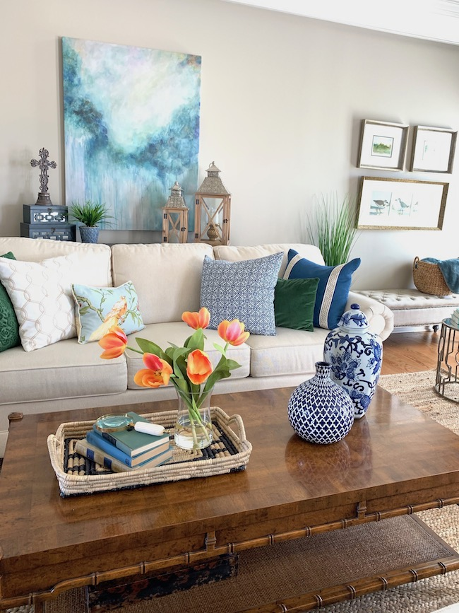 See how Kim at Perfecting Places uses vibrant coral., blue, and green to decorate for spring.